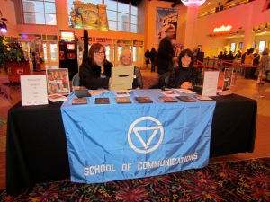 Marie Ullrich, Deb Barko, and Suzanne Zack staff the table at the film premiere.