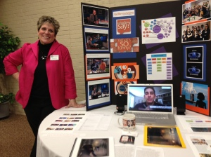 Roberts stands with her 2014 sabbatical presentation